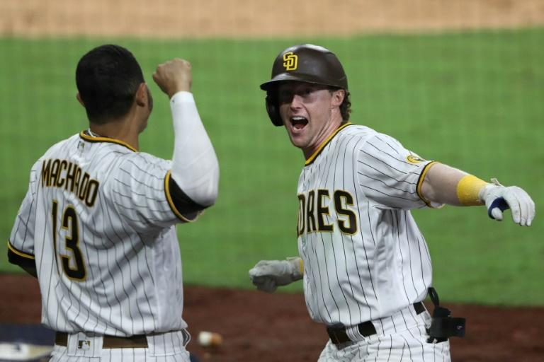 Padres use nine pitchers to oust Cardinals, Marlins blank Cubs to advance
