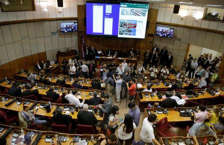 A view of the room is seen as lawmakers argue over a possible change in law that would allow President Horacio Cartes to run for re-election, in Asuncion, Paraguay March 28, 2017. REUTERS/Jorge Adorno