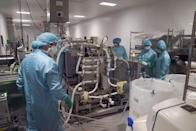 Staff work in a laboratory before a visit by Foreign Secretary Dominic Raab