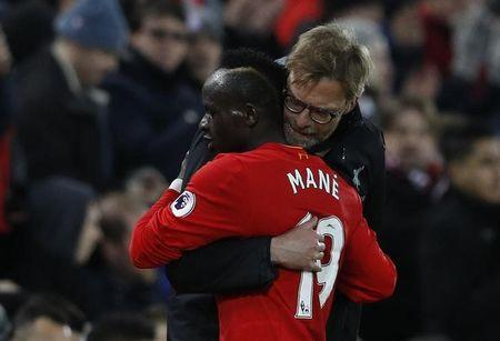 Britain Soccer Football - Liverpool v Arsenal - Premier League - Anfield - 4/3/17 Liverpool's Sadio Mane with Liverpool manager Juergen Klopp after the match  Reuters / Phil Noble Livepic