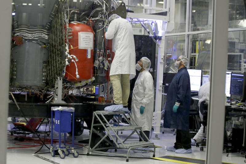 SpaceX employees work on the Crew Dragon spacecraft that will take astronauts to and from the International Space Station, from American soil, as part of the agency's commercial crew Program, in Hawthorne, Calif., Thursday, Oct. 10, 2019. (AP Photo/Alex Gallardo)