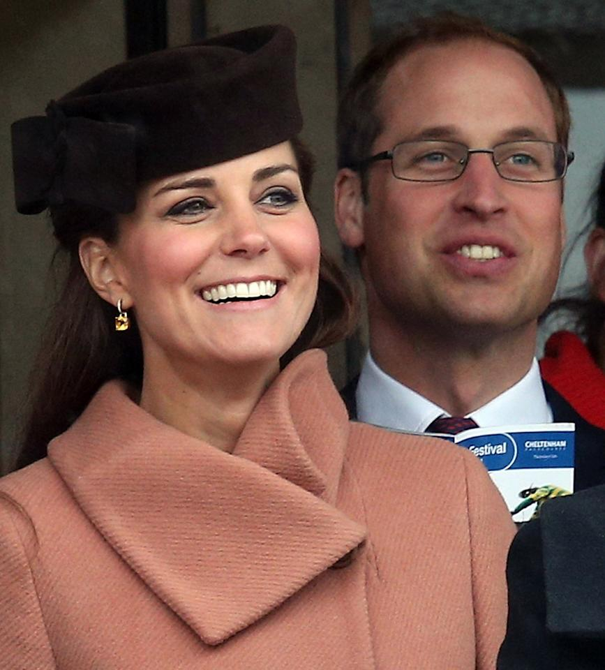 CHELTENHAM, ENGLAND - MARCH 15:  Catherine, Duchess of Cambridge and Prince William, Duke of Cambridge watch the races on Gold Cup Day at Cheltenham Racecourse on the fourth and final day of the Cheltenham Festival 2013 on March 15, 2013 in Cheltenham, England. Approximately 200,000 racing enthusiasts are expected at the four-day festival, which ends today and is seen as many as the highlight of the jump racing calendar.   (Photo by Matt Cardy/Getty Images)