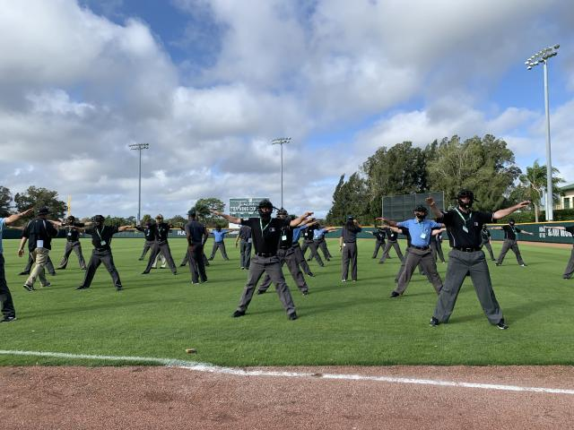 The aspiring umpires at the instructional camp in Vero Beach practice making definitive, emphatic signals in large groups. (Photo by Hannah Keyser/Yahoo Sports)