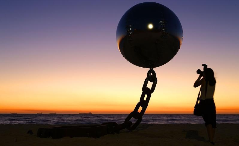A fan takes in Norton Flavel's Lucky Country at Sculpture by the Sea. Picture by Paul Kane/Getty Images