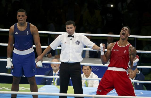 2016 Rio Olympics - Boxing - Final - Men's Super Heavy (+91kg) Final Bout 273 - Riocentro - Pavilion 6 - Rio de Janeiro, Brazil - 21/08/2016. Tony Yoka (FRA) of France celebrates after winning his bout against Joseph Joyce (GBR) of Britain. REUTERS/Matthew Childs FOR EDITORIAL USE ONLY. NOT FOR SALE FOR MARKETING OR ADVERTISING CAMPAIGNS.