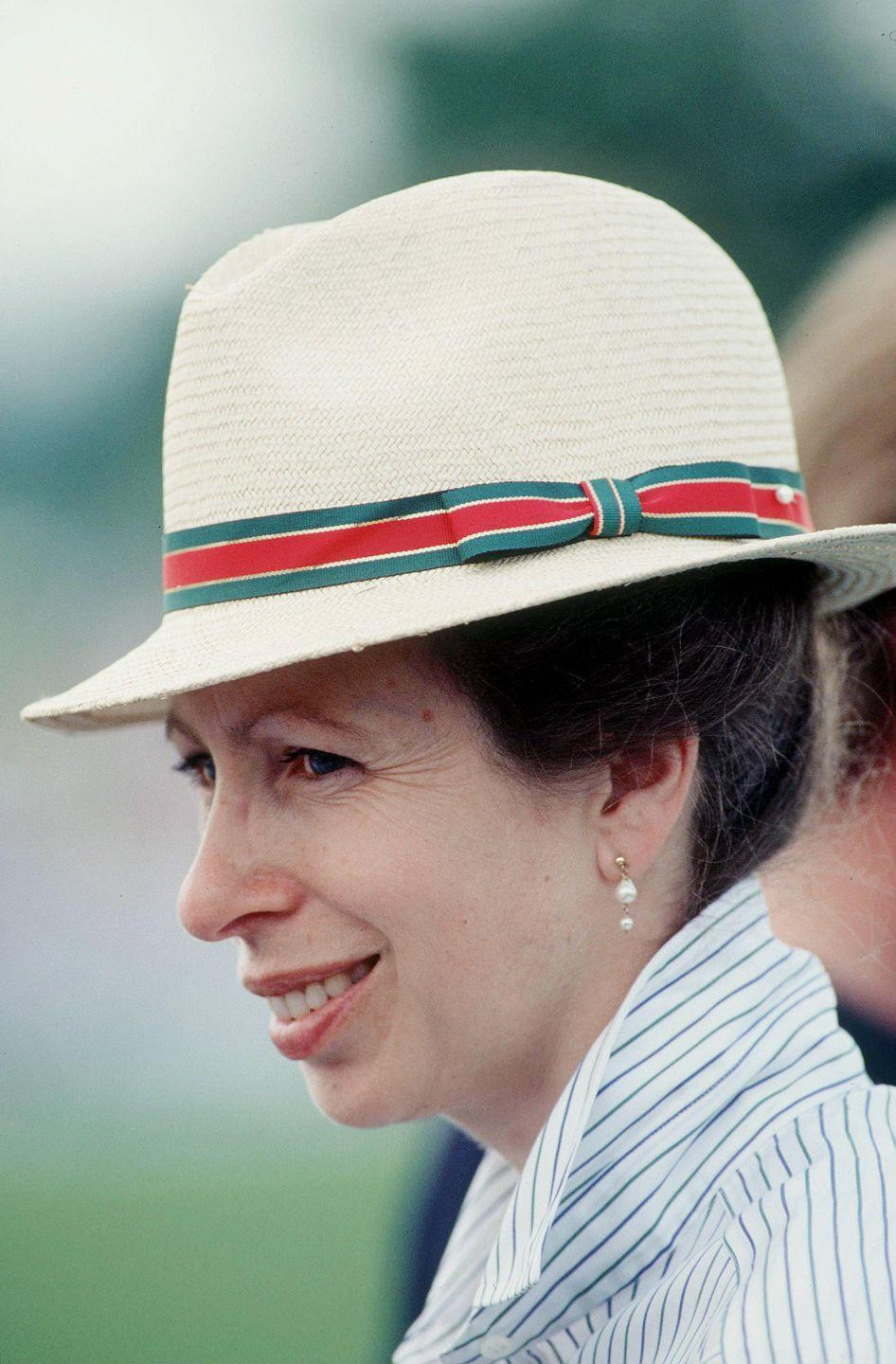 <p>Princess Anne chose a jaunty fedora with striped detailing, plus a striped button-down, for the Windsor International Horse Trials. </p>