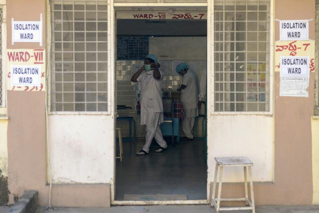 Medical nurses are seen inside an isolation ward as patients (unseen) coming from Hong Kong requested medical checks as a preventative measure following a coronavirus outbreak.