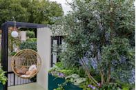 """<p>Balconies have been a lifeline for so many over the pandemic — and this Sky Sanctuary Balcony Garden designed by Michael Coley celebrates just that. With an on-trend hanging egg chair, outdoor lights and colourful borders, it shows how a small space can be used to the max. </p><p>""""More and more of us are living in flats high up off the ground with limited outdoor space,"""" say the designers. """"This garden is meant to represent a getaway from the hustle and bustle of the street below. A simple usable space to relax and let your troubles unwind."""" </p>"""