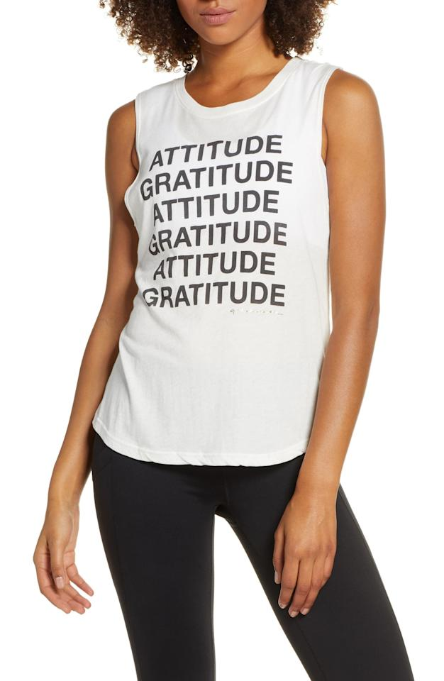 "<p>This cute <a href=""https://www.popsugar.com/buy/Spiritual-Gratitude-Muscle-Tank-490401?p_name=Spiritual%20Gratitude%20Muscle%20Tank&retailer=shop.nordstrom.com&pid=490401&price=48&evar1=fit%3Aus&evar9=44198583&evar98=https%3A%2F%2Fwww.popsugar.com%2Fphoto-gallery%2F44198583%2Fimage%2F46615109%2FSpiritual-Gratitude-Muscle-Tank&list1=shopping%2Cgifts%2Choliday%2Cgift%20guide%2Cworkouts%2Cfitness%20gifts%2Cgifts%20for%20women&prop13=api&pdata=1"" rel=""nofollow"" data-shoppable-link=""1"" target=""_blank"" class=""ga-track"" data-ga-category=""Related"" data-ga-label=""https://shop.nordstrom.com/s/spiritual-gratitude-muscle-tank/5328876?origin=category-personalizedsort&amp;breadcrumb=Home%2FWomen%2FClothing%2FActivewear&amp;color=stone"" data-ga-action=""In-Line Links"">Spiritual Gratitude Muscle Tank</a> ($48) reminds them of what's important.</p>"