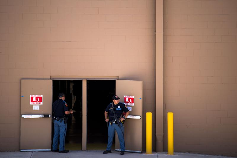 Law enforcement agencies cover the exits of a Walmart where a shooting occurred near Cielo Vista Mall in El Paso, Texas, Saturday, Aug. 3, 2019. | JOEL ANGEL JUAREZ—AFP/Getty Images