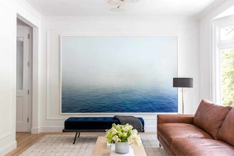 Grant Gibson lets a 10' x 6' Peggy Wong photograph take center stage in a client's living room.