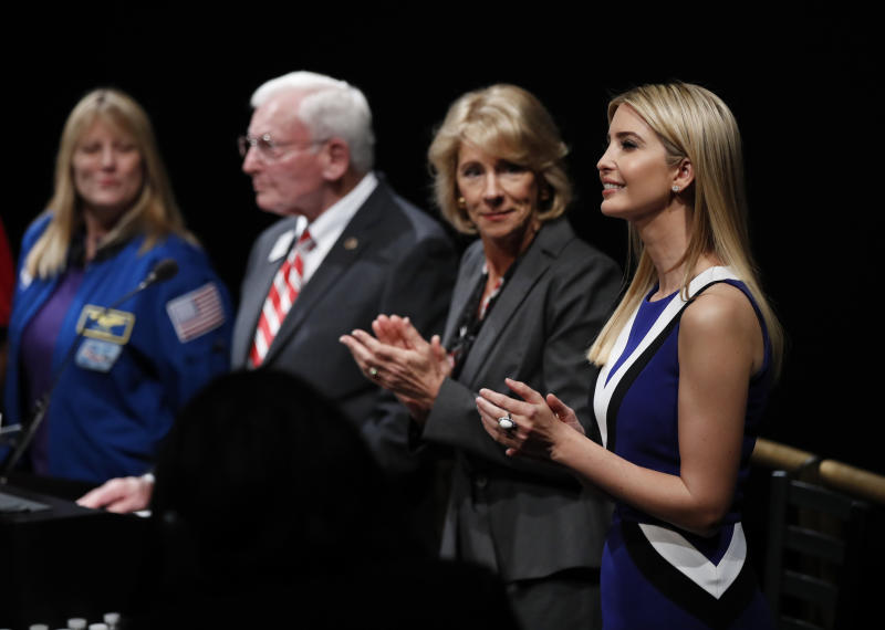 """From right, Ivanka Trump, Education Secretary Betsy DeVos, John R. """"Jack"""" Dailey, director of the National Air and Space Museum and NASA Astronaut Kay Hire, applaud at the Smithsonian's National Air and Space Museum in Washington, Tuesday, March 28, 2017, during an event to celebrate Women's History Month. (AP Photo/Manuel Balce Ceneta)"""