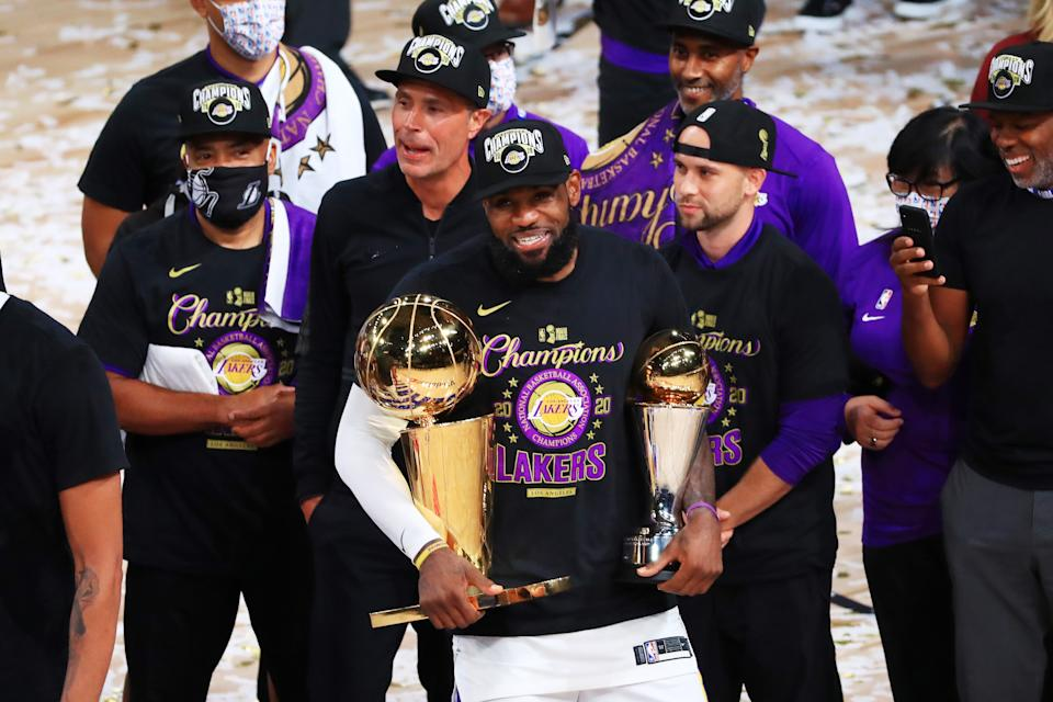 LeBron James and the Los Angeles Lakers begin their title defense on Tuesday. (Mike Ehrmann/Getty Images)