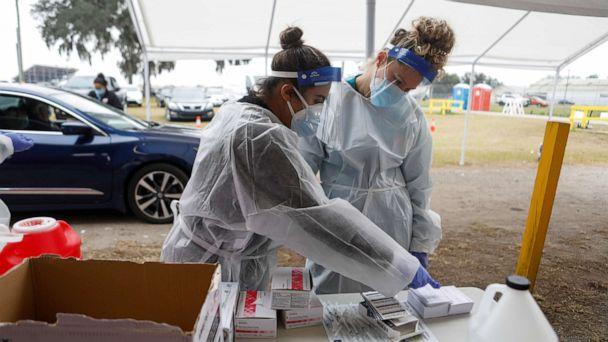 PHOTO: Medical workers prepare to administer Pfizer-BioNTech COVID-19 vaccines at a drive-through COVID-19 vaccination site at the Strawberry Festival Fairgrounds in Plant City, Fla., Jan. 13, 2021. (Octavio Jones/Reuters)