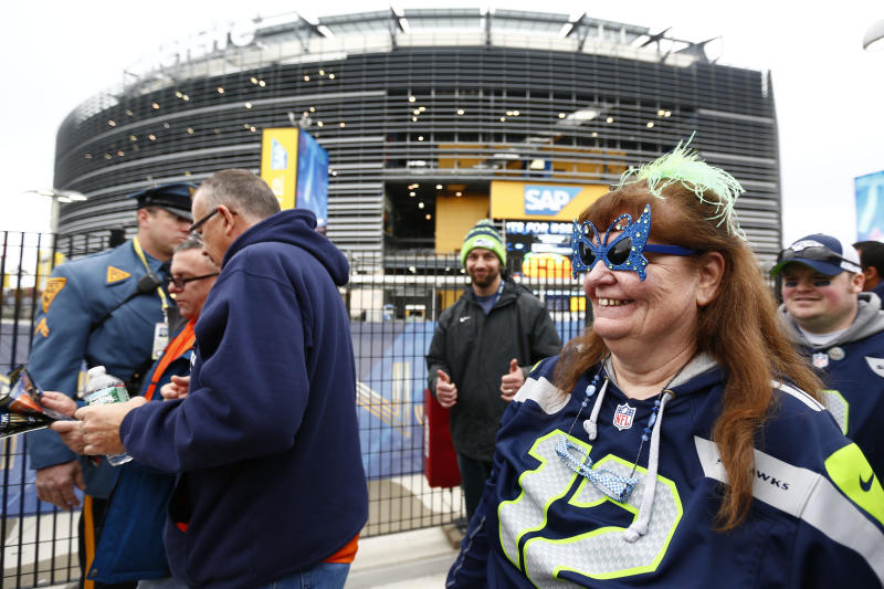 Football fans arrive at MetLife Stadium, Sunday, Feb. 2, 2014, in East Rutherford, N.J. The Seattle Seahawks are scheduled to play the Denver Broncos in NFL football's Super Bowl XLVIII game on Sunday evening. (AP Photo/Matt Rourke)