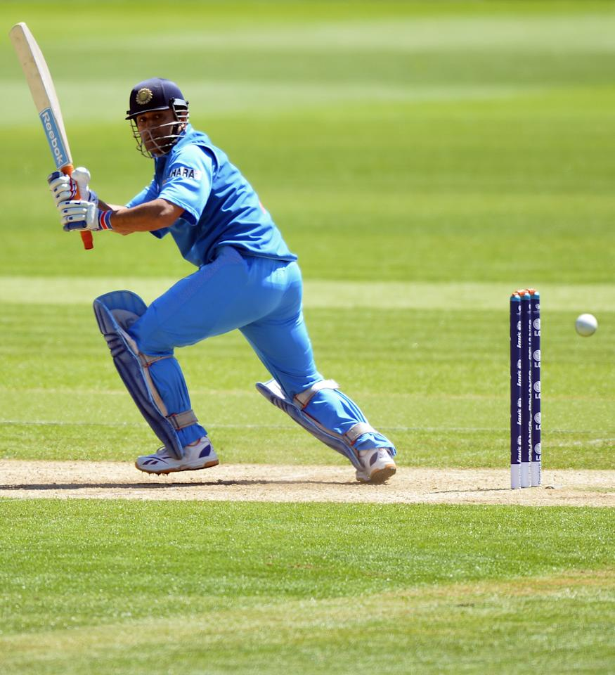 India's captain Mahendra Singh Dhoni plays a shot during the warm-up cricket match ahead of the 2013 ICC Champions Trophy between India and Australia at The Cardiff Wales Stadium in Cardiff, Wales on June 4, 2013.  India won the toss and elected to bat first.  AFP PHOTO/Paul ELLIS        (Photo credit should read PAUL ELLIS/AFP/Getty Images)