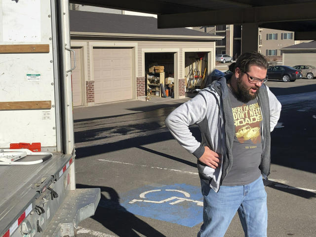 George Jankowski, a furloughed U.S. Department of Agriculture worker, helps a friend move out of an apartment in Cheyenne, Wyo., Monday, Jan. 14, 2019. Jankowski was paid $30 for his help. Many federal workers are doing odd jobs or driving for ride-hailing apps to help make ends meet during the partial federal government shutdown. (AP Photo/Mead Gruver)