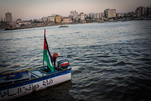 <p>Madleen Koolab takes Gazan's out for rides on Thursday nights, a popular night for families. Madleen owns the boat and uses it to fish during the week. (Photograph by Monique Jaques) </p>