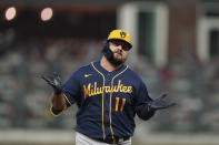 Milwaukee Brewers' Rowdy Tellez celebrates after hitting a two-run homer during the fifth inning of Game 4 of a baseball National League Division Series against the Atlanta Braves, Tuesday, Oct. 12, 2021, in Atlanta. (AP Photo/Brynn Anderson)