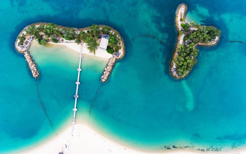 The secluded island of Sentosa, a quarter of a mile from the city state's southeast coast, is Singapore's premier holiday resort - This content is subject to copyright.