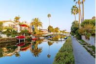 """<p><strong>Venice Canals</strong></p><p>Visiting the <a href=""""https://www.visitveniceca.com/2015/07/23/venice-canals/"""" rel=""""nofollow noopener"""" target=""""_blank"""" data-ylk=""""slk:Venice Canals"""" class=""""link rapid-noclick-resp"""">Venice Canals</a> in Venice, California, makes you feel like you're in Europe (except with palm trees). Made up of six waterways–Carroll, Linnie, Howland, Sherman, Eastern, and Grand and approximately one and a half miles in length–the canals are perfect for a self-guided bike or walk.</p>"""