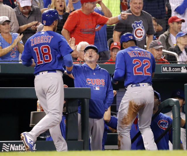 Chicago Cubs' Joe Maddon, center, congratulates Ben Zobrist (18) and Jason Heyward (22) after both players scored against the St. Louis Cardinals during the fifth inning of a baseball game, Sunday, July 29, 2018, in St. Louis. (AP Photo/Jeff Roberson)