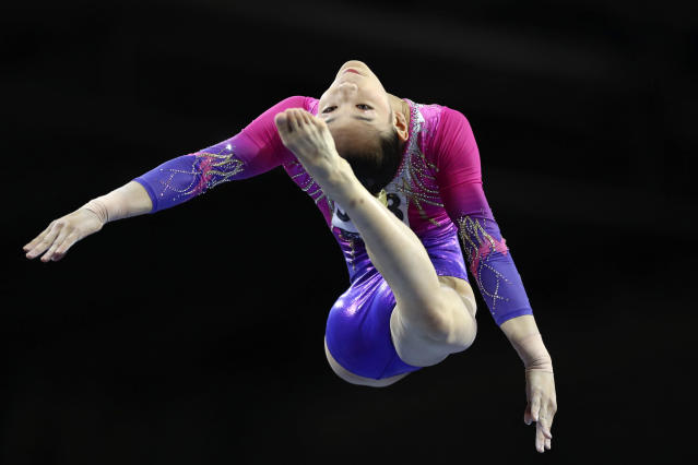 Tang Xijing of China performs on the balance beam in the women's all-around final at the Gymnastics World Championships in Stuttgart, Germany, Thursday, Oct. 10, 2019. (AP Photo/Matthias Schrader)