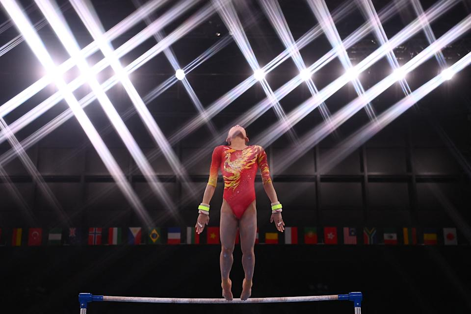 <p>TOPSHOT - China's Xijing Tang competes in the uneven bars event of the artistic gymnastics women's team final during the Tokyo 2020 Olympic Games at the Ariake Gymnastics Centre in Tokyo on July 27, 2021. (Photo by Loic VENANCE / AFP) (Photo by LOIC VENANCE/AFP via Getty Images)</p>