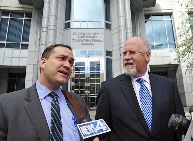 FILE - In this June 7, 2012 file photo, former developer and lobbyist Harvey Whittemore, right, and his attorney John Arrascada speak to the media after Whittemore's arraignment in federal court. Whittemore, a Nevada powerbroker who headed a billion-dollar real estate company and pulled the strings of state politics as a prominent lobbyist for more than a decade, was convicted Wednesday, May 29, 2013 of making illegal campaign contributions to U.S. Sen. Harry Reid.  Jurors said they were deadlocked on another count of lying to the FBI, and the judge asked them to continue deliberating. (AP Photo/The Reno Gazette-Journal, Tim Dunn, File)