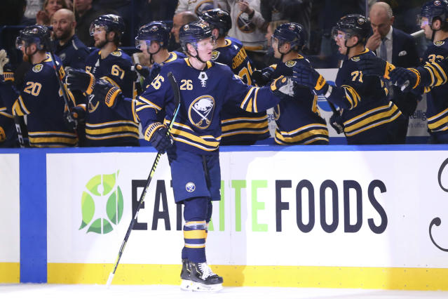 Buffalo Sabres defenseman Rasmus Dahlin (26) celebrates his goal during the second period of an NHL hockey game against the Anaheim Ducks, Sunday, Feb. 9, 2020, in Buffalo, N.Y. (AP Photo/Jeffrey T. Barnes)