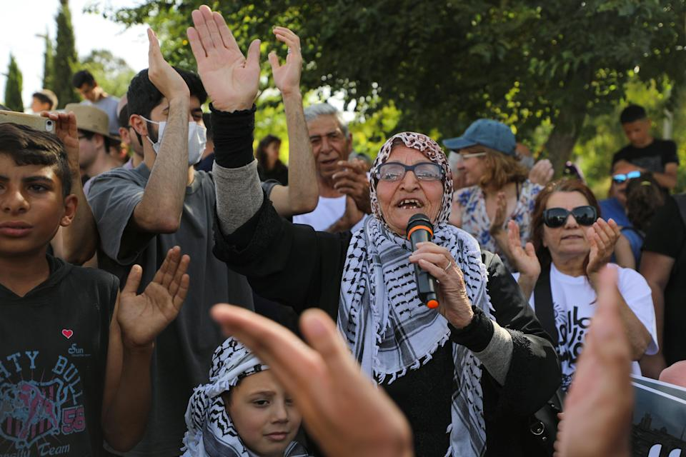 Protesters take part in a demonstration on 11 June against the proposed eviction of Palestinian families in Sheikh Jarrah (Reuters)