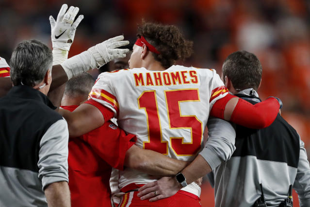 Patrick Mahomes left Thursday's game against the Broncos early with a knee injury. (AP Photo/David Zalubowski)