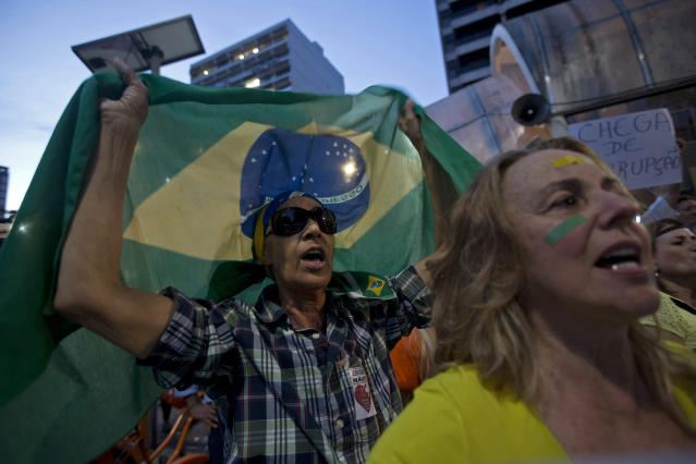 Residents of the Ipanema neighborhood shout during an anti-government protest in Rio de Janeiro, Brazil, Friday, June 21, 2013. Demonstrations began as an outcry against a 10-cent hike in bus and subway fares in Brazil's largest cities, but have continued even after announcements that the increases would be rescinded. Protesters have expressed frustration with corruption and what they say are high taxes and poor public services. They've demanded everything from education reforms to free bus fares while denouncing the billions of public dollars spent on stadiums before the World Cup and the Olympics. (AP Photo/Silvia Izquierdo)