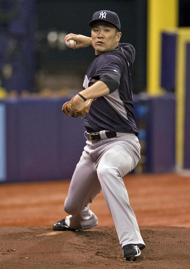 New York Yankees pitcher Masahiro Tanaka throws in the bullpen before a baseball game between the Yankees and the Tampa Bay Rays Saturday, Aug. 16, 2014, in St. Petersburg, Fla. (AP Photo/Steve Nesius)