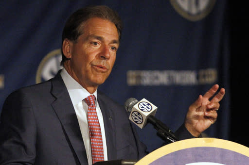 Alabama coach Nick Saban speaks to the media at the Southeastern Conference NCAA college football media days Thursday, July 17, 2014, in Hoover, Ala. (AP Photo/Butch Dill)