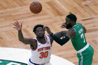 New York Knicks forward Julius Randle (30) looks up to catch a pass as Boston Celtics guard Jaylen Brown (7) defends during the first half of an NBA basketball game Wednesday, April 7, 2021, in Boston. (AP Photo/Charles Krupa)