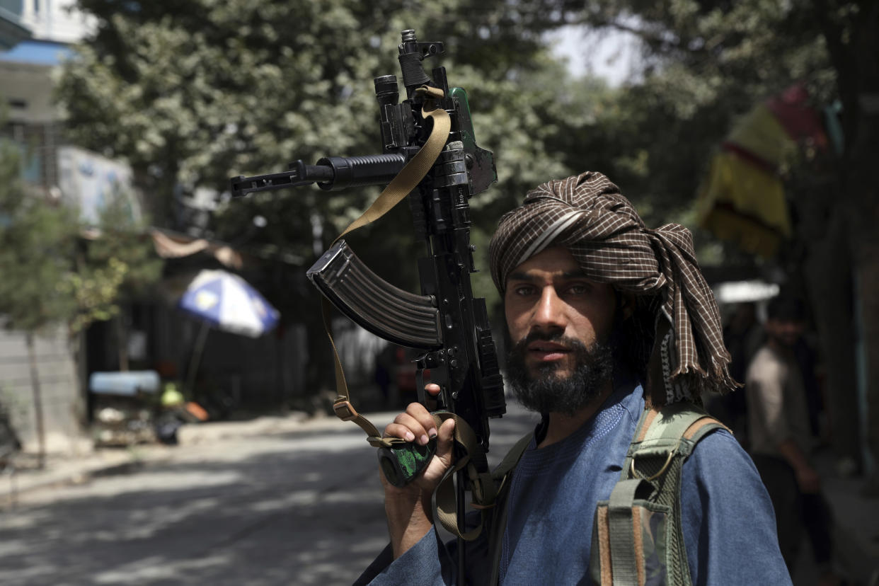A Taliban fighter mans a checkpoint in the Wazir Akbar Khan neighborhood in Kabul, on Aug. 18, 2021.