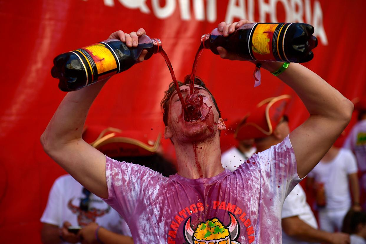Reveler gets down to Saturday on the first day of the San Fermin Fiesta that features the annual running of the bulls. (Photo: ASSOCIATED PRESS)