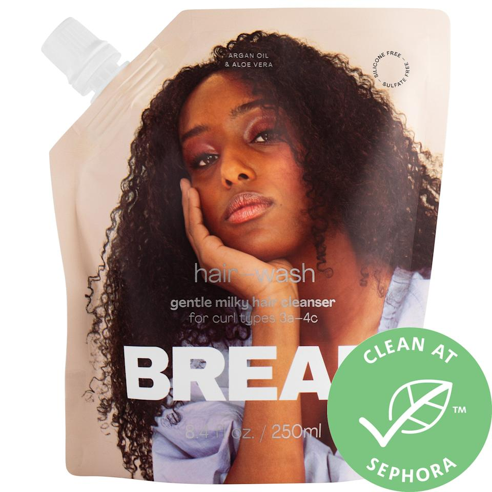 """<p>The first thing I noticed when applying the <product href=""""https://www.sephora.com/product/bread-beauty-hair-wash-gentle-milky-hair-cleanser-P460549?icid2=products%20grid:p460549"""" target=""""_blank"""" class=""""ga-track"""" data-ga-category=""""Related"""" data-ga-label=""""https://www.sephora.com/product/bread-beauty-hair-wash-gentle-milky-hair-cleanser-P460549?icid2=products%20grid:p460549"""" data-ga-action=""""In-Line Links"""">Bread Beauty Supply Hair Wash Gentle Milky Hair Cleanser</product> ($20) was its lather . . . and it made me do a double-take of the label. Typically, the sulfate-free shampoos I've used don't offer much in the way of foam  - a small price to pay to not have the stripping that often accompanies bubbles - but this cleanser <em>is</em> in fact sulfate-free as well. In addition to a definite clean feeling, my hair felt more moisturized right after rinsing it out (thanks to argan oil and aloe vera juice inside).<br><br> Oh, and <a href=""""https://www.popsugar.com/beauty/best-clean-curly-hair-products-47298588"""" class=""""ga-track"""" data-ga-category=""""Related"""" data-ga-label=""""https://www.popsugar.com/beauty/best-clean-curly-hair-products-47298588"""" data-ga-action=""""In-Line Links"""">speaking of clean</a>: This lightweight shampoo (and the rest of the Bread products) are also vegan and cruelty-free.</p>"""