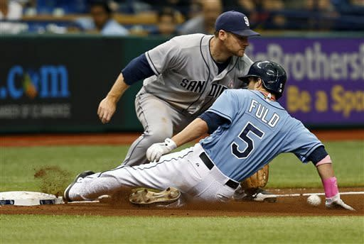Tampa Bay Rays' Sam Fuld (5) slides in safely with a triple as San Diego Padres third baseman Chase Headley waits for the throw during the fifth inning of an interleague baseball game on Sunday, May 12, 2013, in St. Petersburg, Fla. (AP Photo/Mike Carlson)