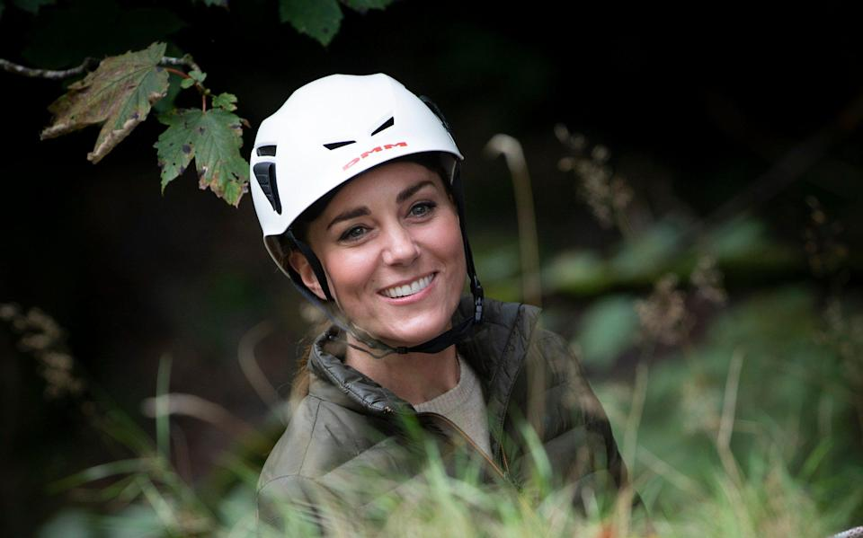 Kate is all smiles as she tries her hand at abseiling