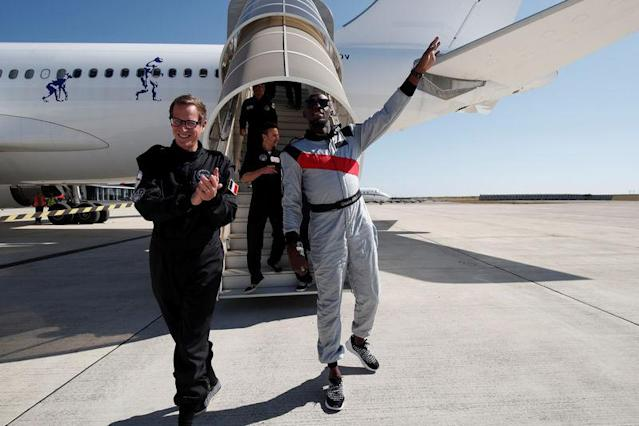Retired sprinter Usain Bolt and Quentin Meurisse from Martell Mumm Perrier-Jou't after they enjoyed zero gravity conditions during a flight in a specially modified Airbus Zero-G plane above Reims, France, September 12, 2018. REUTERS/Benoit Tessier