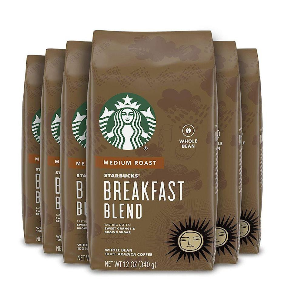 "<p><strong>Starbucks</strong></p><p>amazon.com</p><p><strong>$35.27</strong></p><p><a href=""https://www.amazon.com/dp/B01EYCI6KK?tag=syn-yahoo-20&ascsubtag=%5Bartid%7C10050.g.36302897%5Bsrc%7Cyahoo-us"" rel=""nofollow noopener"" target=""_blank"" data-ylk=""slk:Shop Now"" class=""link rapid-noclick-resp"">Shop Now</a></p><p><strong><em>Starbucks Breakfast Blend Medium Whole Bean Coffee</em></strong></p><p>Can you imagine life without coffee? The first Starbucks opened in Seattle in 1971 and has grown to be the most distinguished coffee shop in the world. Pick up a pack of Starbucks Breakfast Blend Whole Bean Coffee and raise a mug, because without Starbucks, we don't know where we would be in life.</p>"
