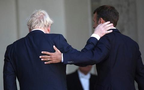 French President Emmanuel Macron (right) and Britain's Prime Minister Boris Johnson walk into the Elysee Palace after addressing the press - Credit:  Daniel Cole/ AP