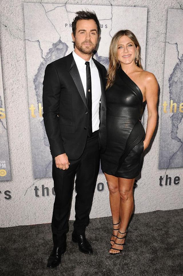<p>Justin Theroux and Jennifer Aniston wore sleek black looks to the Season 3 premiere of <em>The Leftovers</em> in Los Angeles on April 4. (Photo: Getty Images) </p>