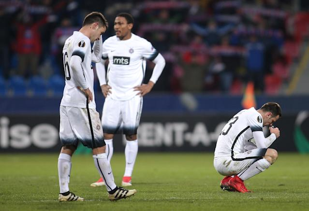 Soccer Football - Europa League Round of 32 Second Leg - Viktoria Plzen vs Partizan Belgrade - Doosan Arena, Plzen, Czech Republic - February 22, 2018 Partizan Belgrade's Bojan Ostojic, Leandre Tawamba and Sasa Zdjelar look dejected REUTERS/Milan Kammermayer