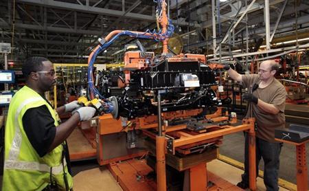 Ford Assembly workers install a battery onto the chassis of a Ford Focus Electric vehicle at the Michigan Assembly Plant in Wayne