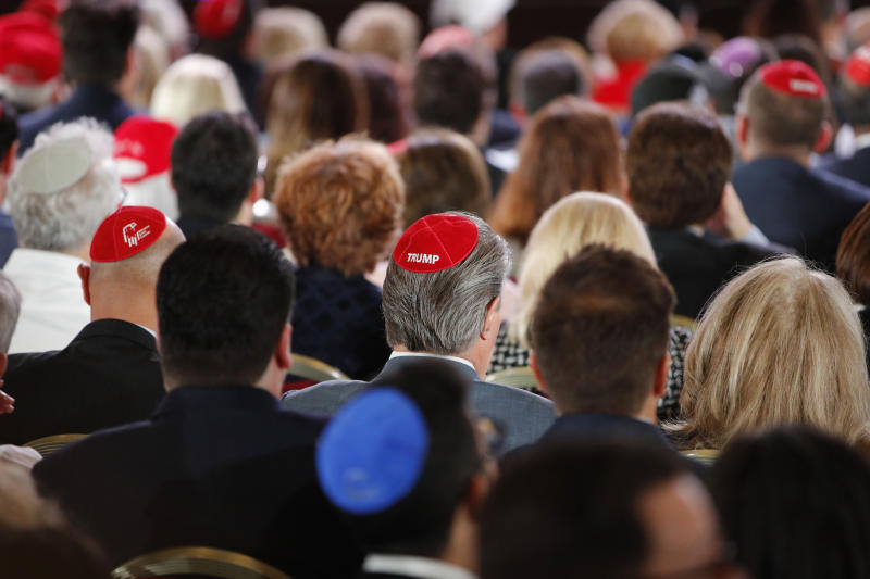"Attendees wear ""Trump"" yarmulkes before President Donald Trump speaks at an annual meeting of the Republican Jewish Coalition, Saturday, April 6, 2019, in Las Vegas. (AP Photo/John Locher)"