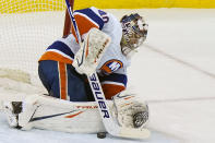 New York Islanders goaltender Semyon Varlamov (40), makes a save during the third period of an NHL hockey game, Tuesday, March 2, 2021, in Newark, N.J. (AP Photo/Kathy Willens)