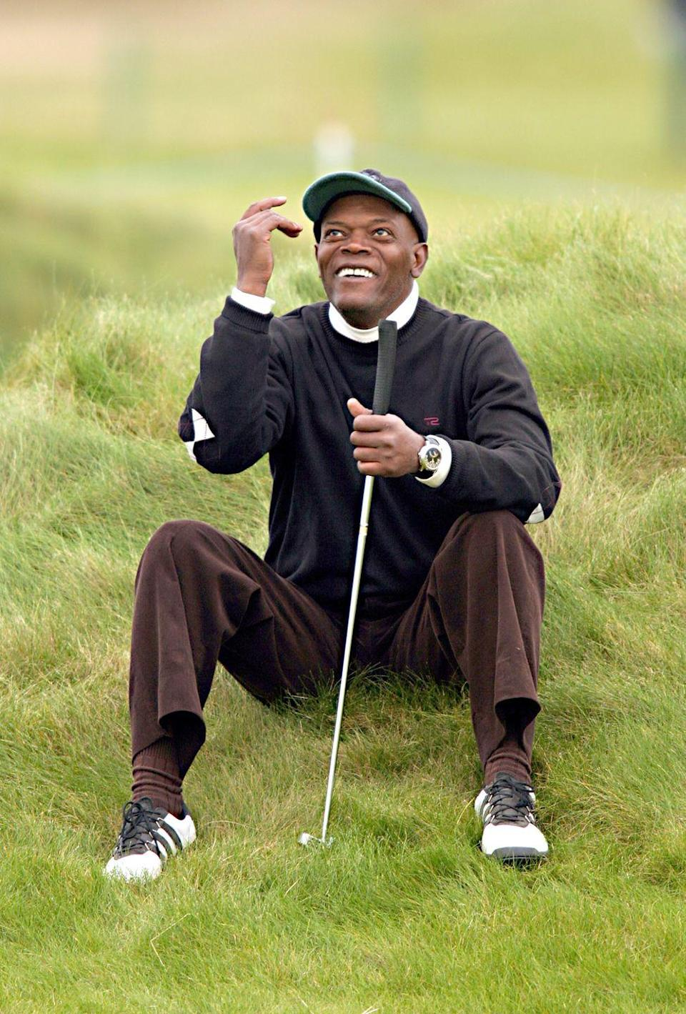 <p>Samuel L. Jackson takes a seat during the third round of the Dunhill Links Championship at the Carnoustie Golf Club in October 2004.</p>
